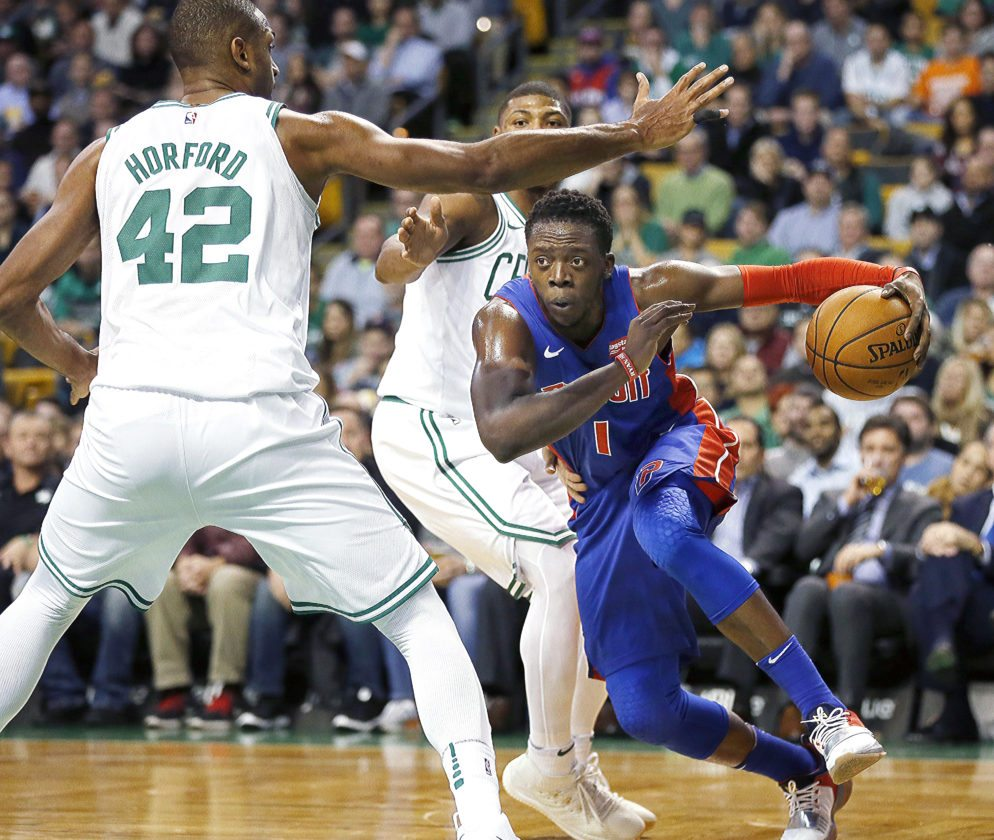 Detroit Pistons' Reggie Jackson (1) drives past Boston Celtics' Al Horford (42) in Boston on Monday. The Pistons won 118-108. (AP Photo/Michael Dwyer)