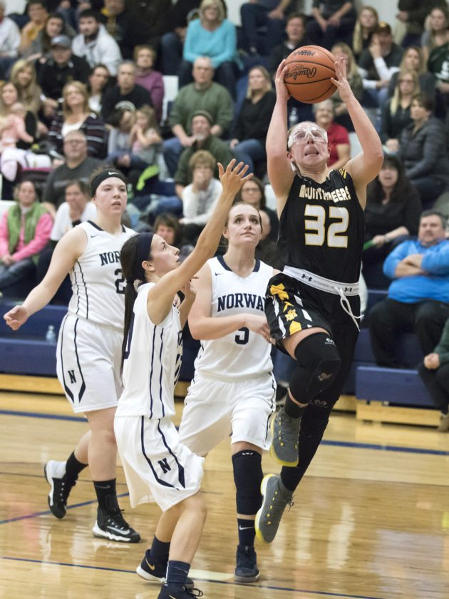 Iron Mountain's Riley Poupore (32) goes for a layup as Norway's Karli Stanchina (10) and Haley Clifford (5) and Teiona Fuson (21) defend on Tuesday, Nov. 28, 2017, in Norway, Mich. (Adam Niemi/Iron Mountain Daily News)