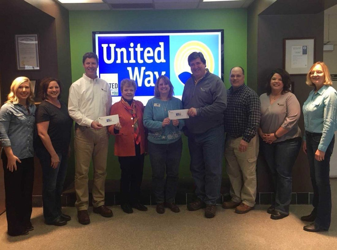 Employees of the Verso Quinnesec Mill made a donation to three area United Ways as a part of the 2018 campaign. Making the check presentations, from left, are Rachael Butler and Dawn Lindstrom of Verso; Mike Glodowski, Verso mill manager; Barb Messer, executive director United Way of Dickinson County; Julie Mallard, executive director United Way of Delta County; and Mark Pontti, Brian LaBrash, LeeAnn Johnson and Patrice Wartick of Verso.