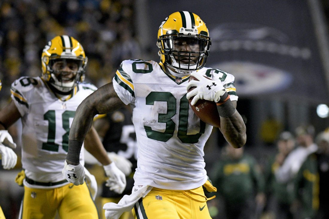 Green Bay Packers running back Jamaal Williams (30) runs through the defense for a touchdown as he plays in an NFL football game against the Pittsburgh Steelers, Sunday, Nov. 26, 2017, in Pittsburgh. (AP Photo/Don Wright)