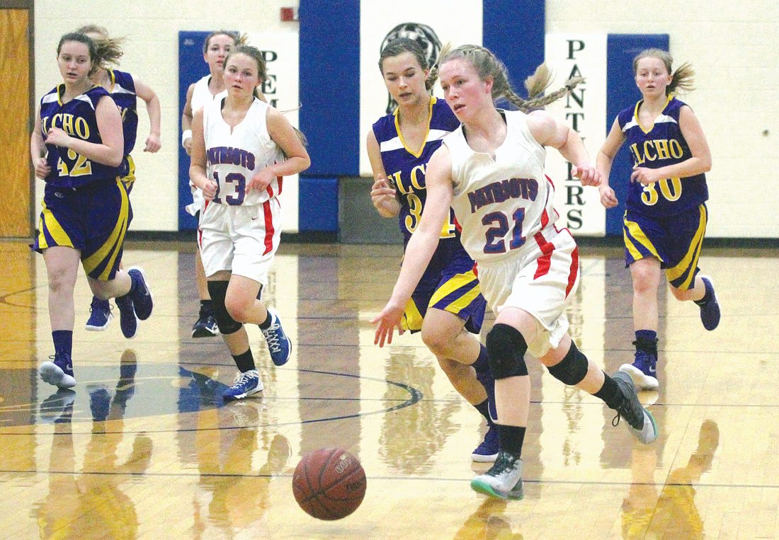Goodman-Pembine's Katelyn Morrison (21) drives against Elcho on Thursday in Pembine, Wis. Morrison had a game-high 26 points in the Patriots' 56-33 loss. (Theresa Proudfit/The Daily News)