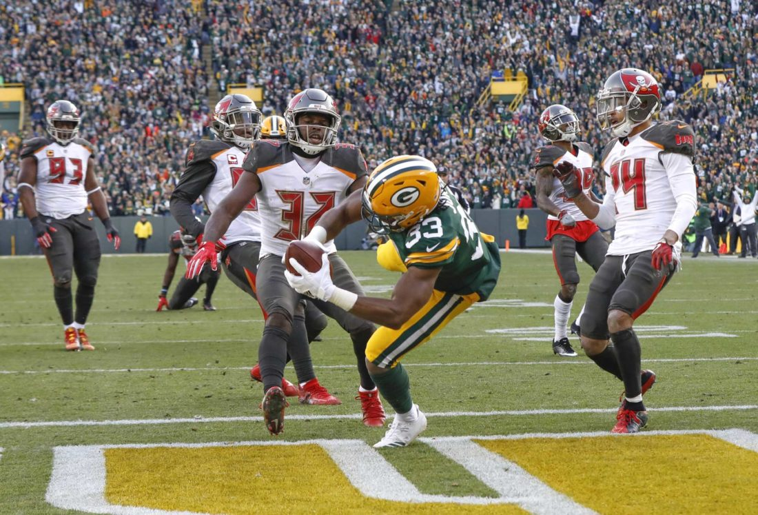 Green Bay Packers' Aaron Jones runs for a touchdown during overtime against the Tampa Bay Buccaneers on Sunday in Green Bay, Wis. The Packers won 26-20. (AP Photo/Mike Roemer)