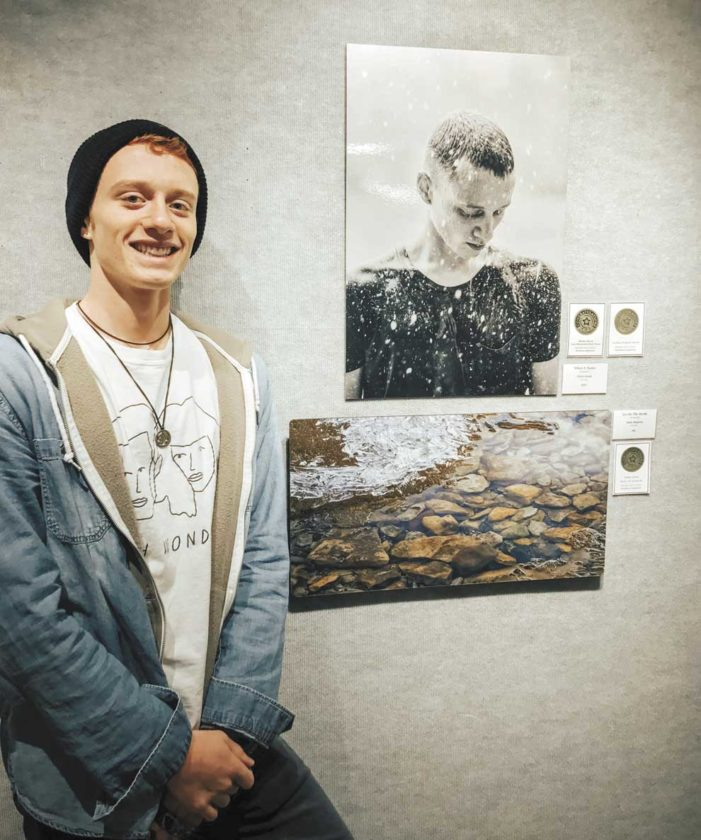 """CHRIS HOOK OF Escanaba with his photo """"When It Rains,"""" which earned him first place both in the Iron Mountain Daily News' Media Awards and in the Student Award category of the Bonifas Arts Center Northern Exposure regional competition."""