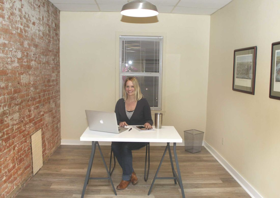 "CWRK COLLECTIVE founder Elsa Faust Pontbriand in one of the shared spaces of the new ""coworking"" office area now open in downtown Iron Mountain. (Theresa Proudfit/Daily News photo)"