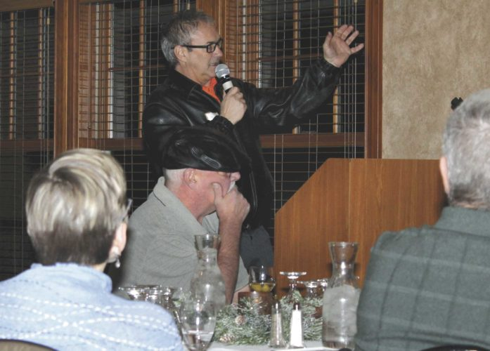 Paul Bujold, Kiwanis Ski Club treasurer, speaks about the major fundraising needed to continue hosting ski jumping competitions at a town hall meeting Tuesday at Pine Grove Country Club. (Theresa Proudfit/Daily News photo)