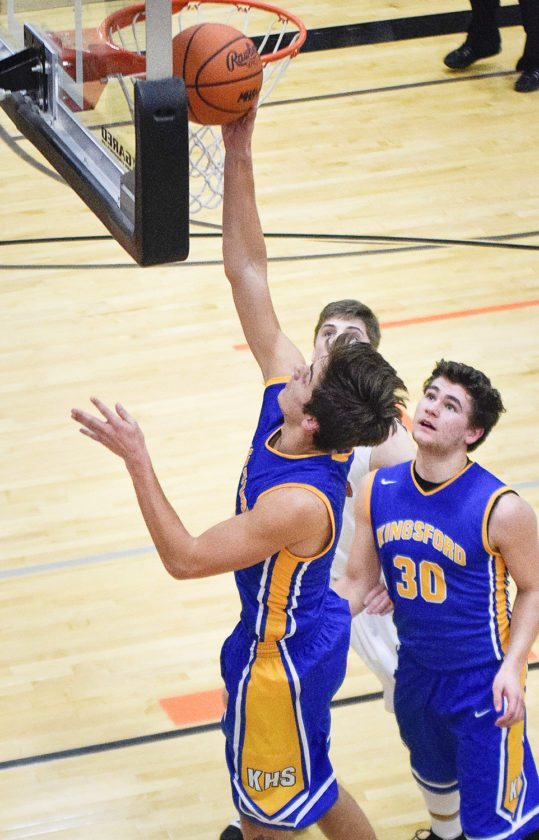 Kingsford's Luke Terrian scores a layup against Houghton on Monday in Houghton. (Bryce Derouin/The Daily Mining Gazette Photo)