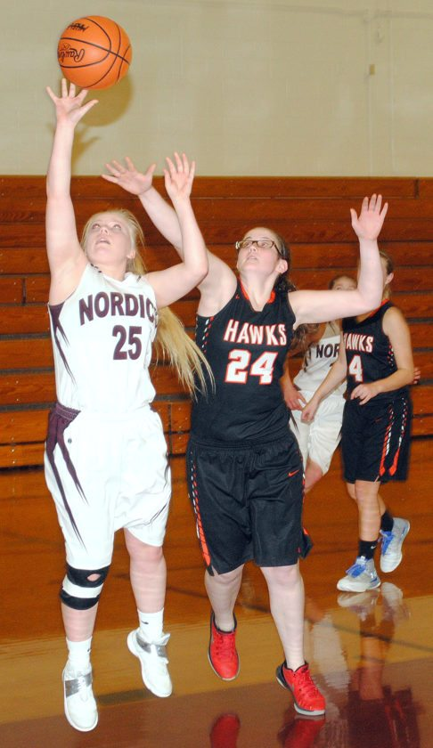 North Dickinson's Brogan Anderson (25) shoots past Republic-Michigamme's Alicia Ball (24) on Tuesday in Felch. (Burt Angeli/The Daily News)