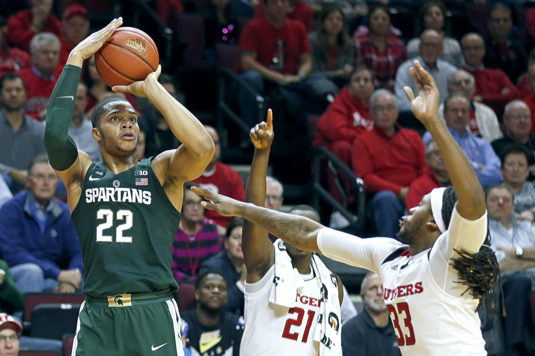 Michigan State guard Miles Bridges (22) shoots over Rutgers forward Deshawn Freeman, right, on Tuesday, Dec. 5, 2017, in Piscataway, N.J. (AP Photo/Adam Hunger)