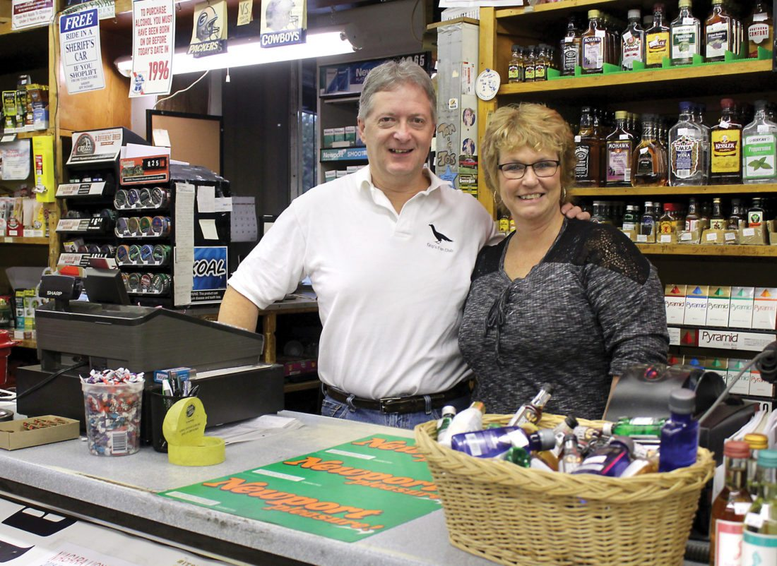 DON AND KELLY MARTIN are the new owners of Tom & Jo's Liquor in Aurora, Wis., but not new to the business, which Kelly Martin's grandparents started 55 years ago. (Theresa Proudfit/Daily News photo)
