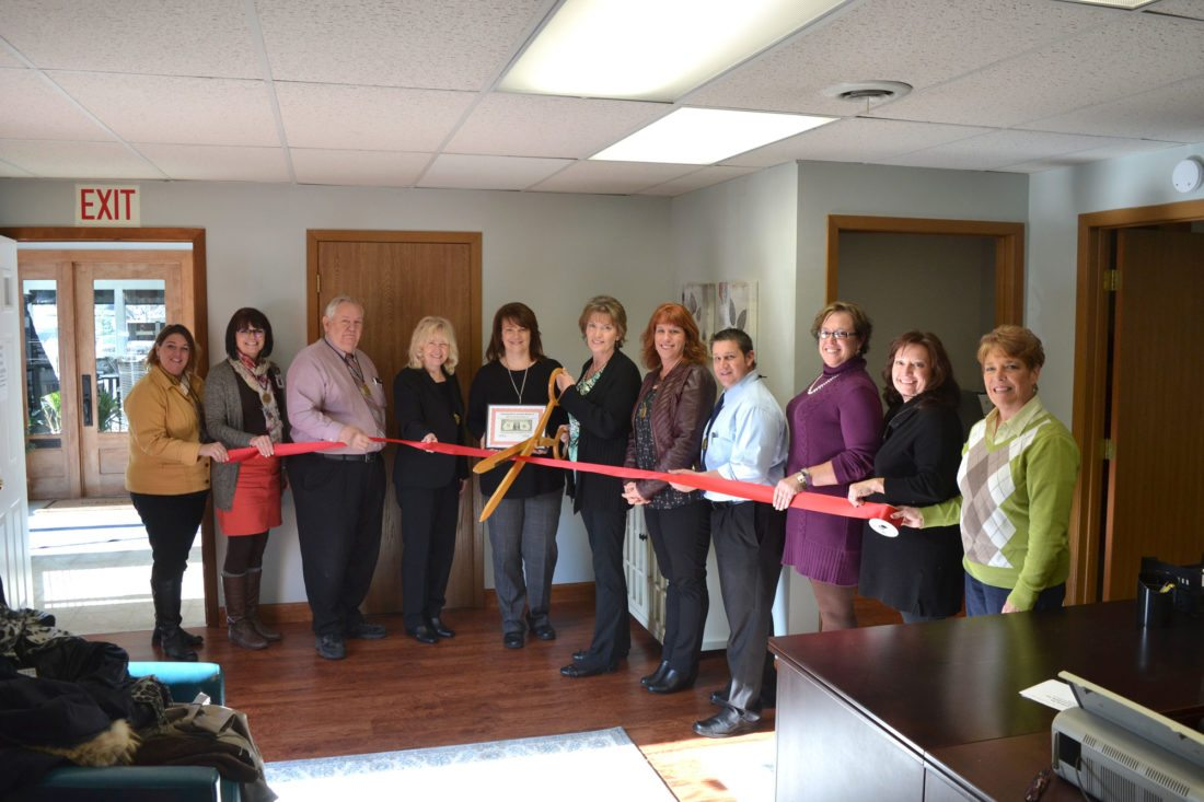 THE DICKINSON AREA Chamber Alliance Ambassadors at the recent ribbon-cutting for C&M Tax and Accounting in Iron Mountain. From left are Denise Lind, Teresa Schettler, Joe Testolin, Patti Schneider, C&M co-owners Valerie Carpenter and Cindy Miller, Chris Hanley, Benjamin Ryan, Elsa Samborski, Tamara Juul and Lynda Zanon. (Chris Tomassucci/Daily News photo)