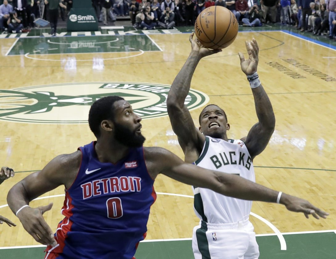 Milwaukee Bucks' Eric Bledsoe shoots over Detroit Pistons' Andre Drummond on Wednesday, Dec. 6, 2017, in Milwaukee. The Bucks won 104-100. (AP Photo/Morry Gash)
