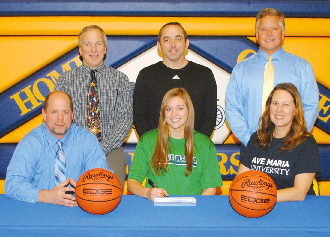 Kingsford High School senior Renee Roberts signed a college basketball national letter of intent Wednesday to attend Ave Maria (Fla.) University. The daughter of Tracy and Doug Roberts (front) was joined at the signing by athletic director Al Unger (from left), girls basketball coach Mike Cross and principal Lyle Smithson. (Burt Angeli/The Daily News)