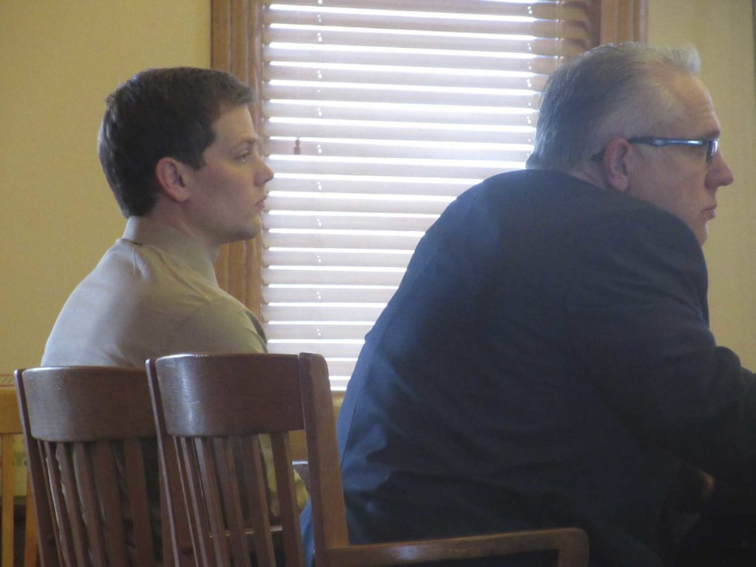 JOSEPH RANKIN, LEFT, listens with his defense attorney, Roy Polich, before the verdict was read Wednesday in Iron County Trial Court. (Nikki Younk/Daily News photo)