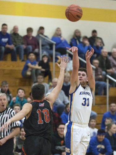 Kingsford's Tyler Beauchamp (30) shoots against Escanaba on Friday, Dec. 8, 2017, in Kingsford, Mich. (Adam Niemi/Iron Mountain Daily News)