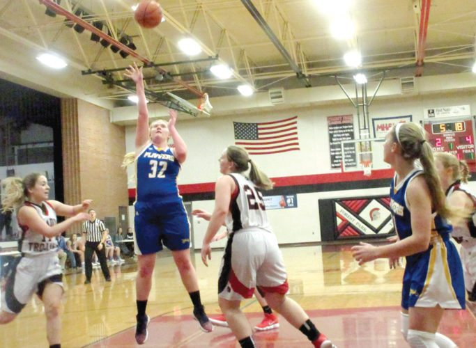 Kingsford's Maddie Koski (32) shoots over Forest Park's Megan Aberly (25) in Friday's game. (Theresa Proudfit/The Daily News)