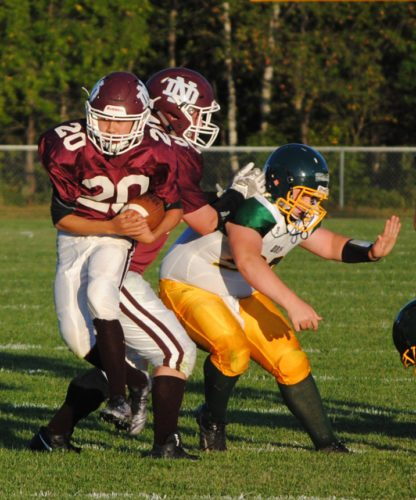 Burt Angeli/The Daily News Photo  North Dickinson quarterback John Nelson carries the football against Carney-Nadeau in eight-player football from this past season.