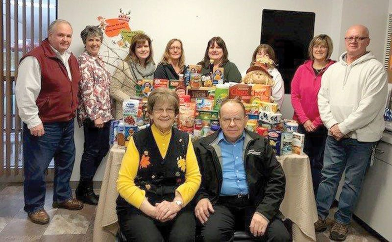 Pictured from left, front row: Tom's Pantry representatives Mary Dixon, president and William Dixon; back row: Trident Maritime Systems employees: Dan Formolo, Lisa Wender, Melanie Roath, Jane Qualley, Michelle Hanson, Mary Pat Madigan, Chris Beauchamp and Chuck Dittbenner.