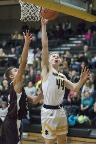 Iron Mountain's Charlie Gerhard (44) goes for a layup as North Dickinson's Joe Roell (32) defends on Monday, Dec. 11, 2017, in Iron Mountain, Mich. (Adam Niemi/Iron Mountain Daily News)