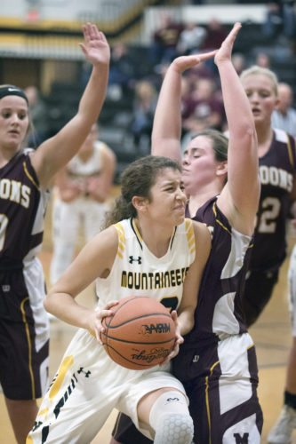 Iron Mountain's Faith Bal (10) drives to the basket against Menominee on Tuesday, Dec. 12, 2017, in Iron Mountain, Mich. (Adam Niemi/Iron Mountain Daily News)