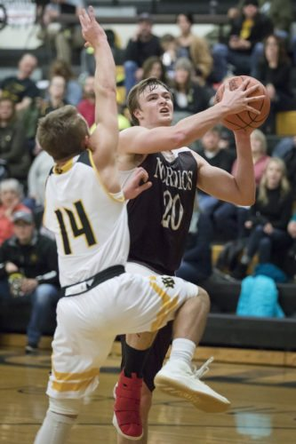 North Dickinson's Matthew Bruette (20), shown in action on Monday, had 20 points for the Nordics in a win Tuesday against Big Bay de Noc. (Adam Niemi/Iron Mountain Daily News, File)