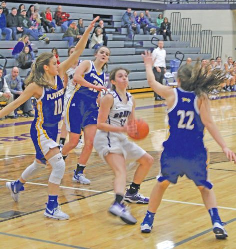 Kingsford's Jordyn Kriegl (10) and Olivia Allen (22) defend against Gladstone's Kaitlyn Hardwick as she gets into the lane during the second quarter Tuesday at Gladstone. (Avery Bundgaard/The Daily Press)