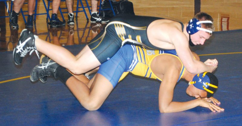 Iron Mountain's Caleb Burklud applies pressure to Kingsford's Ben Stanish in the 189-pound match Tuesday. Burklund registered a pin in the second period. (Burt Angeli/The Daily News)