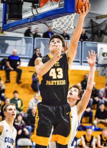 Ewen-Trout Creek's Jake Witt scores a layup in a recent game with Calumet. (Bryce Derouin/The Mining Gazette)