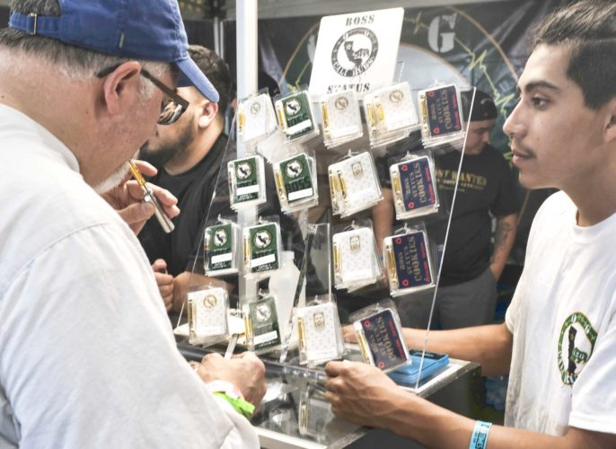 A CUSTOMER TESTS a THC concentrate vaporizers at the High Times Harvest Cup in San Bernardino, Calif. (AP Photo/Richard Vogel, File)