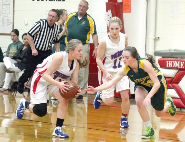 Florence's Jenna Springer (20) defends Goodman-Pembine's Harlee Davis (13) in Thursday's Northern Lakes Conference girls basketball game at Goodman. Patriots' Kirstyn Gardner (11) looks on. (Theresa Proudfit/The Daily News)