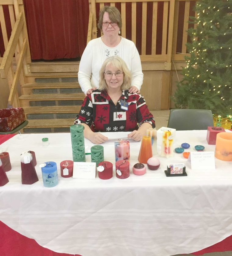 Golden K chairperson Shirley Winters introduces guest speaker Helen Sauld at the Dec. 11 meeting. Sauld does candlemaking out of her home and brought several samples, explaining how and what she does to make them just a bit different from others.