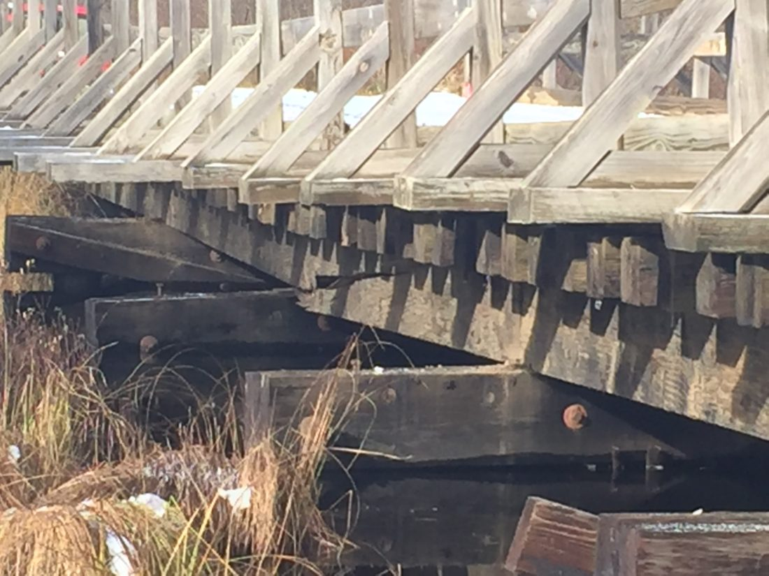 A cracked bridge support beam, shown here, needs to be replaced along Snowmobile Trail No. 8 in Marquette County.
