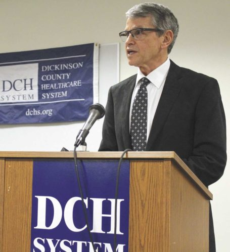 George Kerwin, president and CEO of Bellin Health System, speaks at news conference Dec. 4 to announce Bellin's planned acquisition of Dickinson County Healthcare System. (Theresa Proudfit/Daily News Photo)