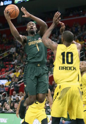 Michigan State guard Joshua Langford (1) goes to the basket against Oakland forward Isaiah Brock (10) on Saturday, Dec. 16, 2017, in Detroit. Langford scored 17 points in a 86-73 win over Oakland. (AP Photo/Duane Burleson)