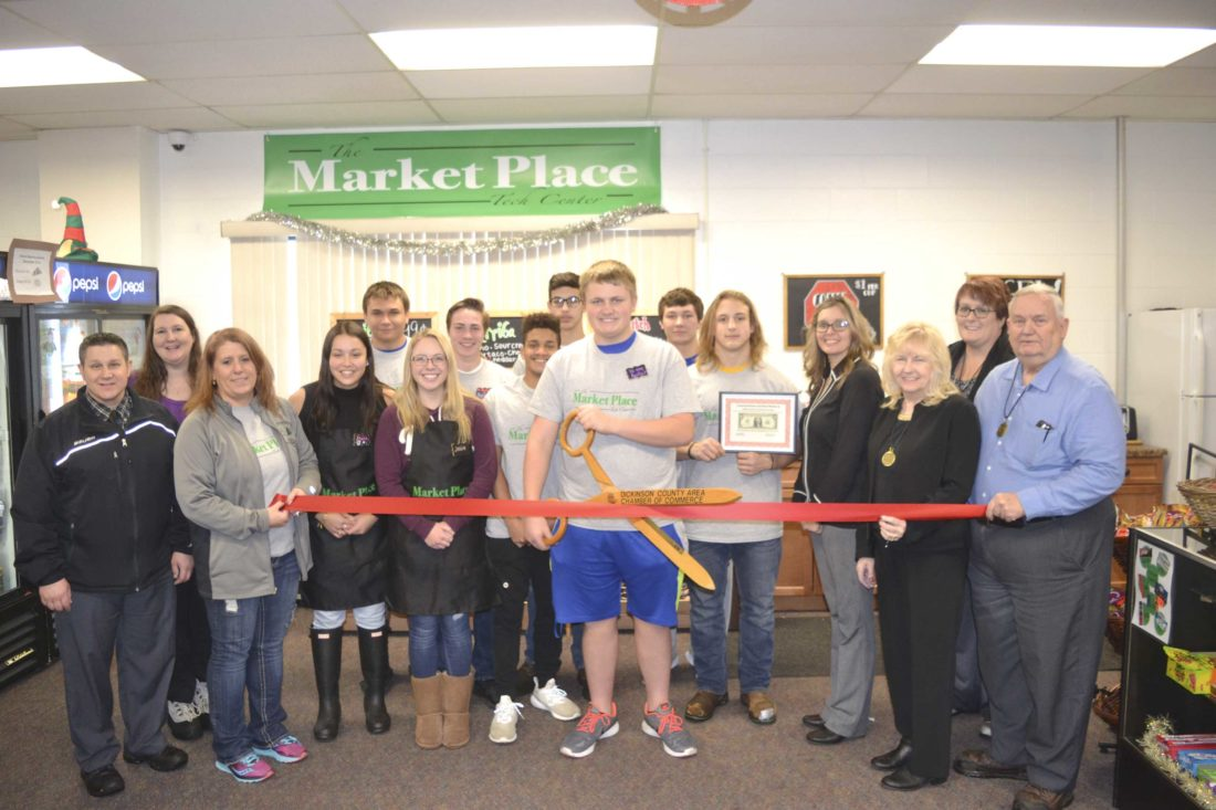 THE DICKINSON AREA Chamber Alliance recently had a ribbon-cutting ceremony for The Market Place, the newly renovated, student-run store at the Dickinson-Iron Intermediate School District Vocational Center. In front, from left, are Ben Ryan, Denise Tapio, Madison Bennett, Josie Yost, Michael Creighton, Austin Hirthe, Aidan Miller, instructor Amy Bracket, Patti Schnieder and Joe Testolin; in back are Kristine Schroeder, Andrew Mann, Preston Strong, Jack Zimmerman, Jonathan Schmutzler and Trisha Peterson. (Chris Tomassucci/Daily News photo)
