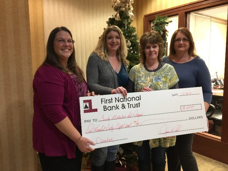 From left are Mindey Fayas, manager of First National Bank & Trust's South Office; Cindi Strehlow and Pam Smart, volunteers for the Trinity Methodist Food Program; and Janis Nord, teller supervisor, First National Bank & Trust's South Office.