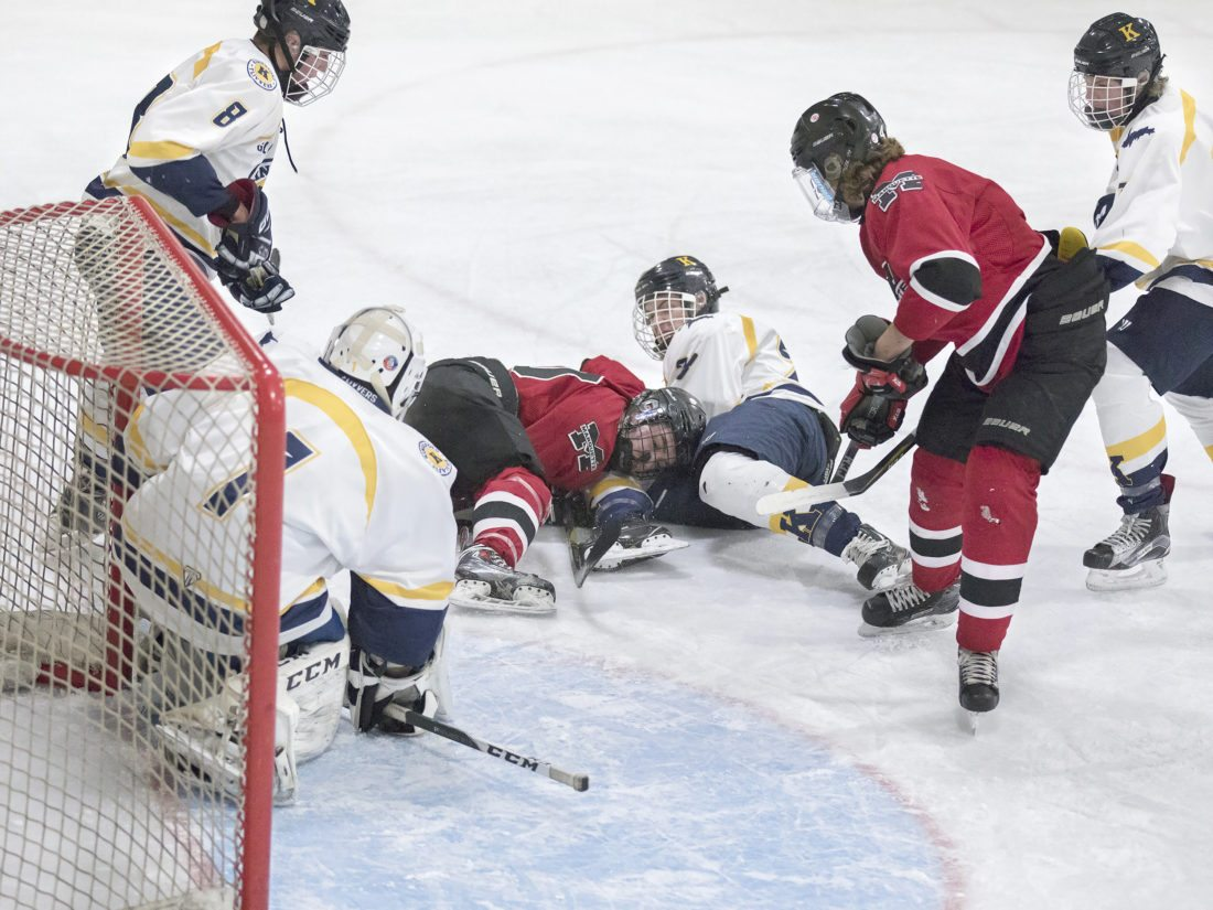 Kingsford goaltender Trevor Anderson (1) and Daunte Fortner (8) look for the puck during a game against Marquette on Thursday, Dec. 21, 2017, in Iron Mountain, Mich. (Adam Niemi/Iron Mountain Daily News)