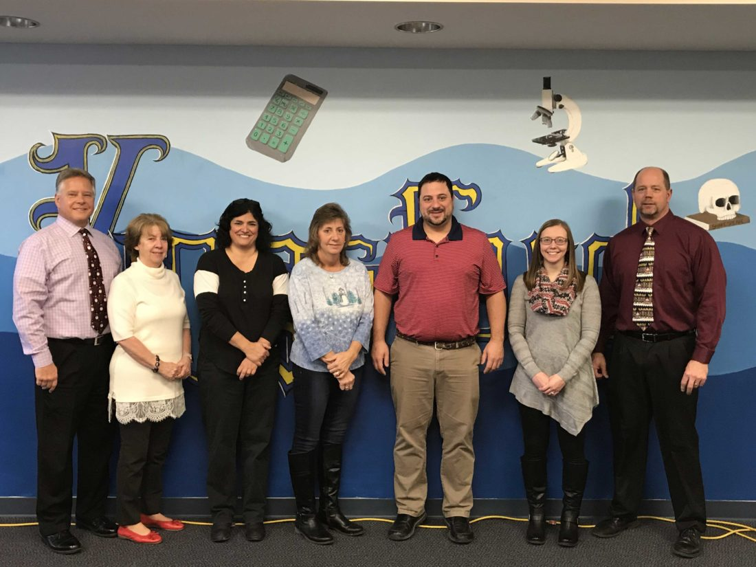 The faculty at Kingsford Middle School has created a new scholarship to KHS students. From left are Lyle Smithson, KHS principal; Rita Edberg, KHS scholarship coordinator; Mary Hofer, Tina Francis, Matt LaLonde, Sara Short, and Doug Roberts, KHS assistant principal.