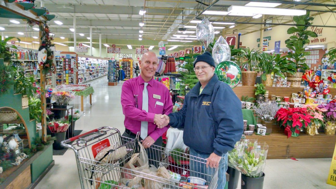 Sons of American Legion Squadron 50 Commander Steve Jacques received this Christmas basket food donation from Tadych's Econofoods manager Dave Mayville. A drawing was to have been done this week at American Legion bingo.