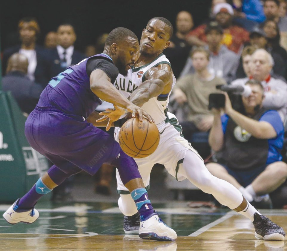 AP Photo Milwaukee's Eric Bledsoe makes a steal attempt on Charlotte's  Nicolas Batum during the second half Friday.