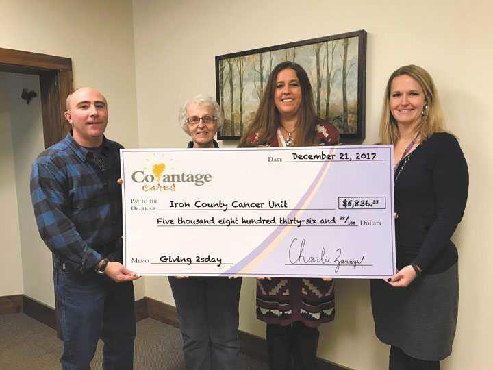 THE COVANTAGE CARES Foundation Giving Tuesday campaign presents a $5,836 check to the Iron County Cancer Unit in Iron River. From left are Kevin Isaacson and Jolene Spoke of the Cancer Unit and Rogene Hemeleski, a CoVantage teller, and Julie LaMay, Iron River branch manager.