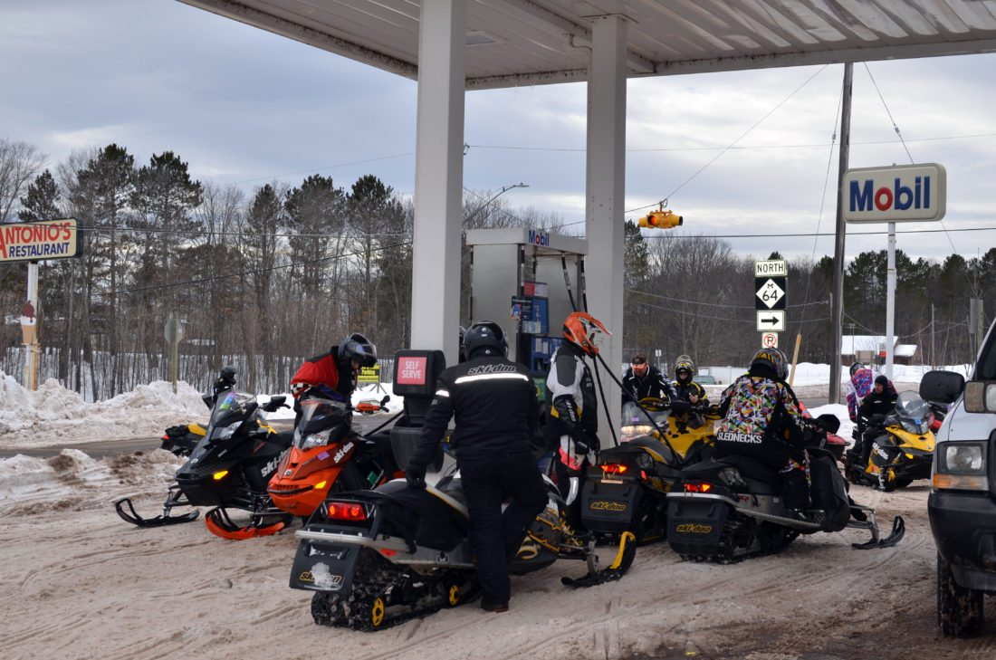 Snowmobilers make a pit stop at a gas station along M-28 in Bergland in Ontonagon County.