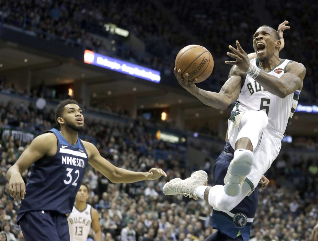 Milwaukee Bucks' Eric Bledsoe shoots past Minnesota Timberwolves' Karl-Anthony Towns on Thursday, Dec. 28, 2017, in Milwaukee. The Bucks won 102-96. (AP Photo/Morry Gash)