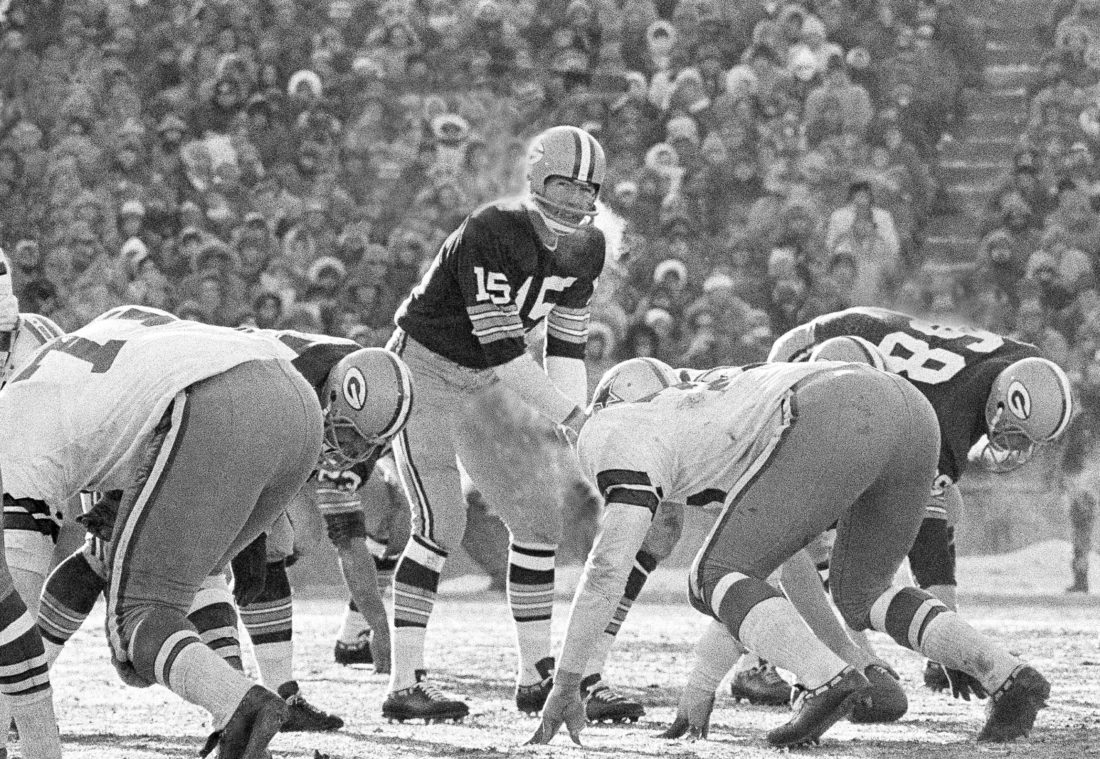 In this Dec. 31, 1967, file photo, Green Bay Packers quarterback Bart Starr calls signals in bitter cold as he led the Packers to a win over the Dallas Cowboys in Green Bay, Wisc. Fifty years later, players from the Packers and Cowboys still shiver from memories of the bitter cold of a game that would become known as the Ice Bowl. (AP Photo/File)