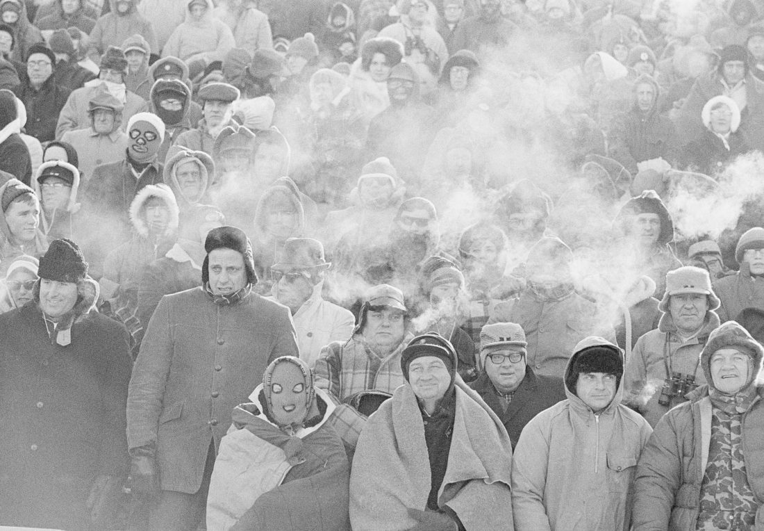 In this Dec. 31, 1967, file photo, fans watch the Green Bay Packers play the Dallas Cowboys in the NFL Championship game in Green Bay, Wisc. Simply dubbed the Ice Bowl, those who participated in Cowboys-Packers that day at Lambeau Field still shiver when talking about it. (AP Photo/File)