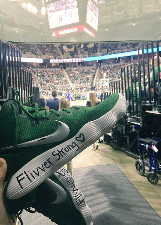 """MICHIGAN STATE UNIVERSITY senior Lexi Gussert,  a former Crystal Falls Forest Park High School star, wore shoes with """"Flivver Strong"""" and a heart during Sunday's Big Ten Conference women's basketball opener with Rutgers in East Lansing. """"My way of honoring Flivver nation,"""" Gussert said on social media."""