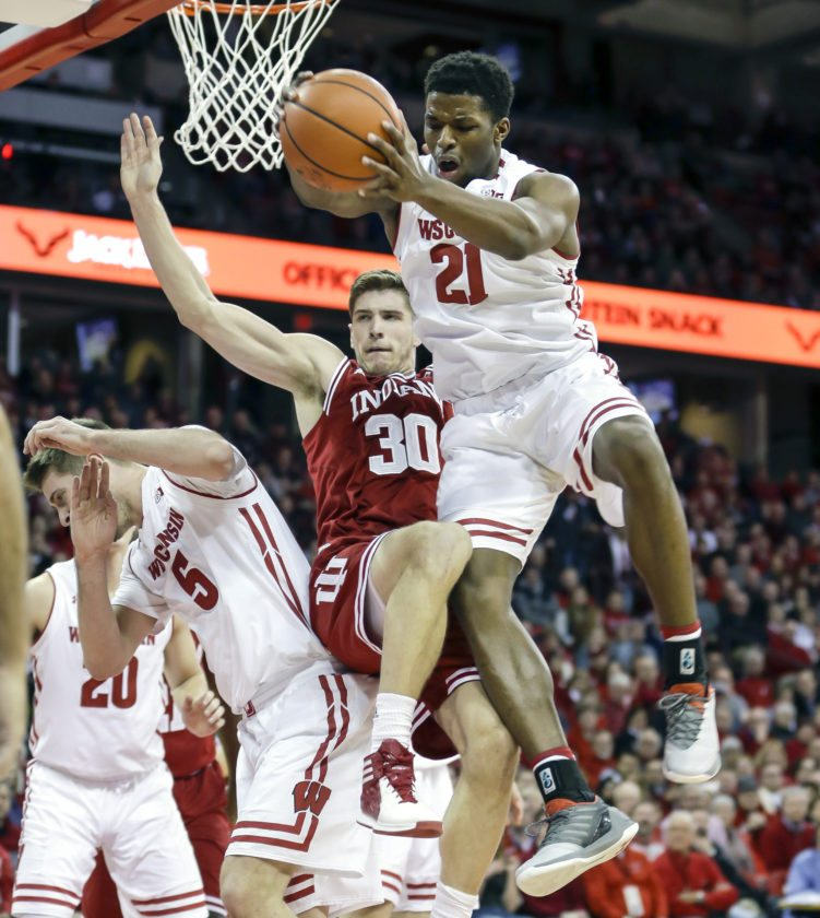 Wisconsin's Khalil Iverson (21) competes for a rebound against Indiana's Collin Hartman (30) on Tuesday, Jan. 2, 2018, in Madison, Wis. (AP Photo/Andy Manis)