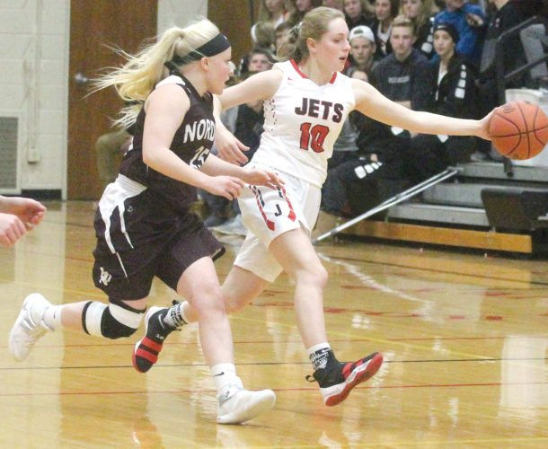 North Central's Hope Plunger (10) grabs the basketball from North Dickinson's Brogan Anderson (25) in Friday's game in Powers. (Theresa Proudfit/The Daily News)