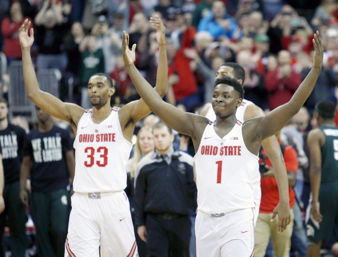 Ohio State forward Keita Bates-Diop, left, and forward Jae'Sean Tate celebrate following their win over Michigan State on Sunday in Columbus, Ohio. (AP Photo/Paul Vernon)