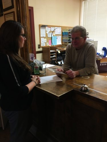 Nikki Mantsch, left, purchases a radon kit at the Dickinson-Iron District Health Department from Louie Johnson, sanitarian. For more information regarding the department's radon program call the Kingsford office at 906-779-7239 or the Iron River office at 906-265-4172.