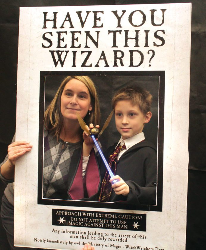 "Tina and Alex Rittenhouse of Florence, Wis., pose in the Transfiguration Photo Booth during ""Christmas in The Wizarding World of Harry Potter.""  (Theresa Proudfit/Daily News photo)"